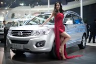 A model poses with a Great Wall Motors 'Haval H6' SUV at the Auto China 2012 car show in Beijing. Automakers are rushing to cash in on China's growing passion for SUVs, with sales up five-fold in the last half-decade, as increasingly affluent urban consumers seek to showcase their wealth