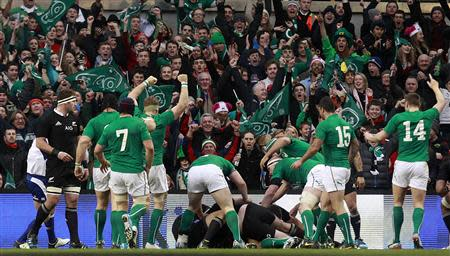 Ireland celebrates scoring against New Zealand in their International rugby union match at Aviva stadium in Dublin