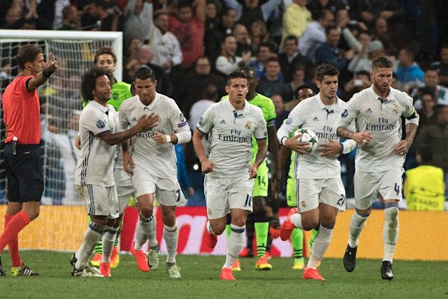 Real Madrid's Cristiano Ronaldo (2nd L) celebrates with teammates after scoring a goal during their UEFA Champions League match against Sporting CP, at the Santiago Bernabeu stadium in Madrid, on