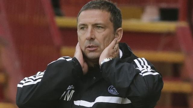 Football - McInnes disappointed by defeat