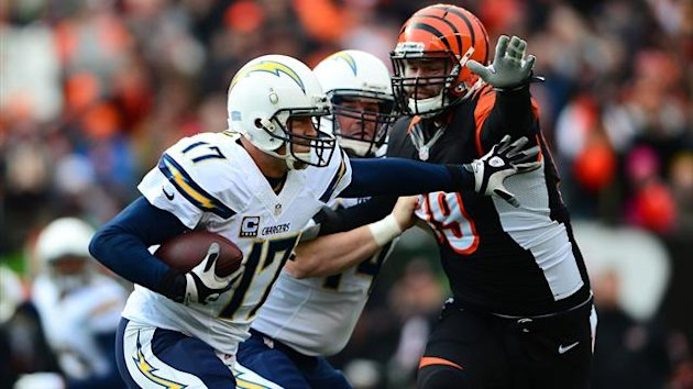 San Diego Chargers quarterback Philip Rivers (17) scrambles out of the pocket during second quarter of the AFC wild card playoff football game against the Cincinnati Bengals at Paul Brown Stadium (Reuters)