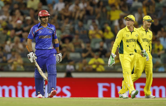 Afghanistan's Mohammad Nabi walks back to the pavilion after being dismissed during their Cricket World Cup Pool A match in Perth, Australia, Wednesday, March 4, 2015. (AP Photo Theron Kirkman)