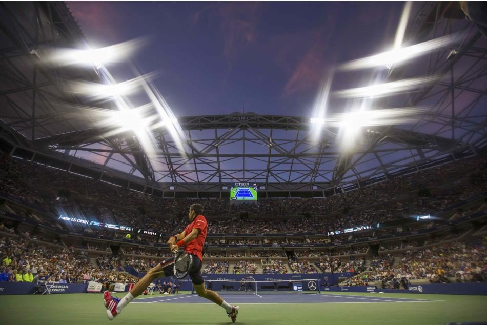 Djokovic of Serbia returns a shot to Agut of Spain during their fourth round match at the U.S. Open Championships tennis tournament in New York,