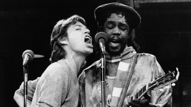 "FILE - In this Dec. 16, 1978 file photo, Mick Jagger, left, of the Rolling Stones, joins Jamaica's reggae musician Peter Tosh during a rehearsal for NBC's ?Saturday Night Live,"" program in New York. For his musical contributions, Tosh's daughter, Niambe, received on Monday, Oct. 15, 2012, the posthumous ""Order of Merit"" for her father, during the island's annual national heroes ceremony. Tosh, a founding member of the reggae band The Wailers along Bob Marley and Bunny Wailer, was killed in 1987 at age 42 by robbers who broke into his Jamaican home. (AP Photo/File)"