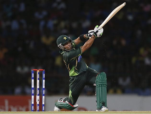 Pakistan's Akmal hits a six during their first Twenty 20 cricket match against Sri Lanka in Colombo