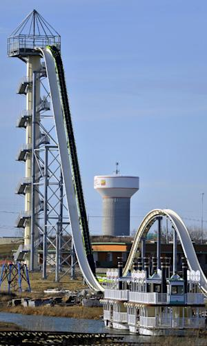 A November 2013 photo shows Schlitterbahn's new Verrückt speed slide/water coaster in Kansas City, Kan. A spokeswoman for the waterpark in Kansas says crews are still trying to fix a mechanical problem with the world's tallest water slide. Unless it can be fixed by Sunday, the ride's official opening may be delayed for a third time.. (AP Photo/The Kansas City Star, Jill Toyoshiba)