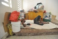 A man left homeless by Hurricane Sandy lies amid his belongings in the Nippes region of Haiti on November 17. Hurricane Sandy, the deadly storm that slammed into New York and New Jersey in October, tore through the Caribbean long before reaching America -- and in Haiti, many still await help.