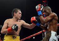 Jeffery Mathebula of South Africa backs away from Nonito Donaire of the Phillipines during the fourth round of the WBO IBF Super Bantamweight title fight at The Home Depot Center on July 7, in Carson, California. Donaire won with a 12-round unanimous decision