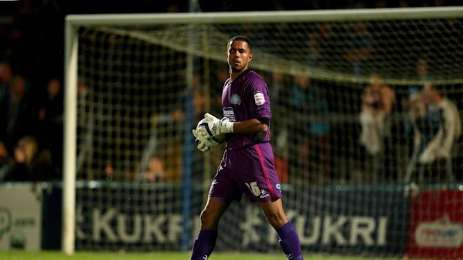 Jordan Archer has extended his stay with Wycombe