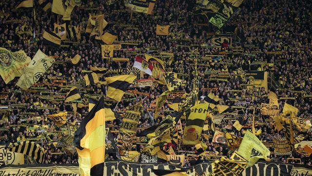 Champions League - 'Moaning' fans dampen Dortmund delight at Europe progress