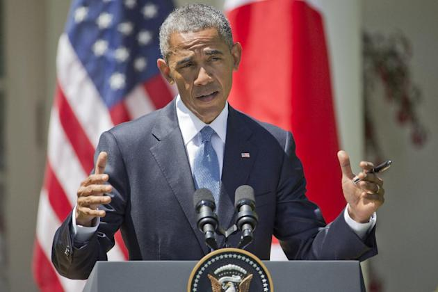 FILE - In this April 28, 2015 file photo, President Barack Obama speaks about recent unrest in Baltimore during his joint news conference with Japanese Prime Minister Shinzo Abe, in the Rose Garden of