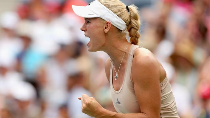 US Open - Wozniacki into final as Peng leaves court in wheelchair