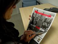 A woman perusing the final print edition of Newsweek in Washington, DC on December 24, 2012. Almost 80 years after first going to print, the final Newsweek magazine hit newsstands featuring an ironic hashtag as a symbol of its Twitter-era transition to an all-digital format