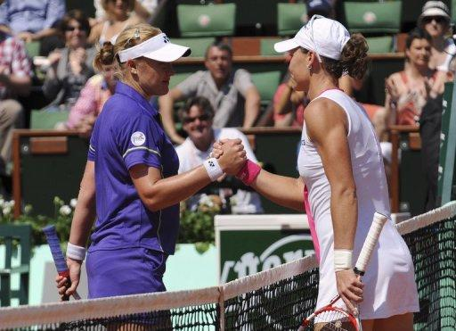 Australia's Samantha Stosur (right) took just over an hour to see off her British rival 6-4, 6-0