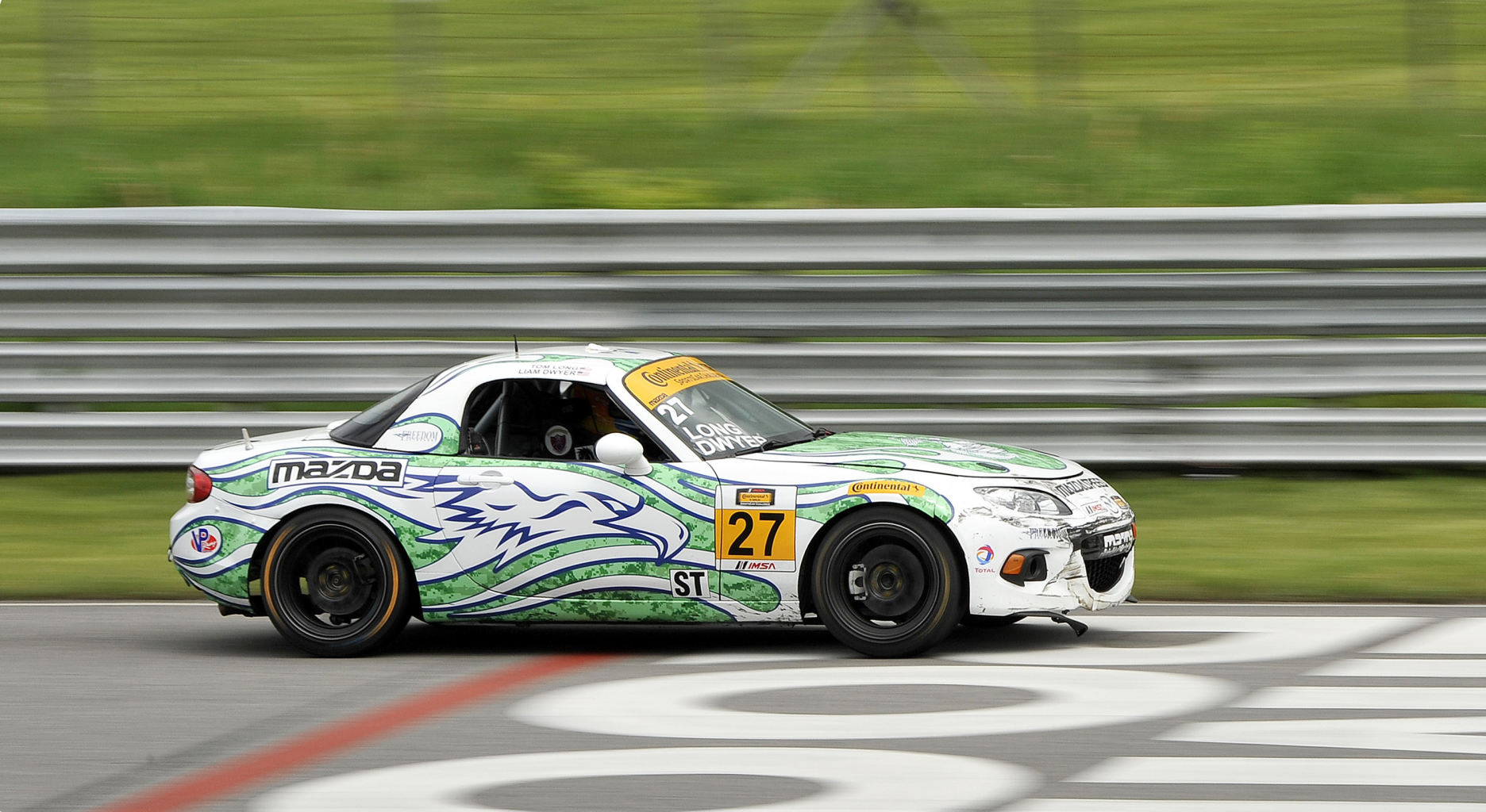 Photo USA for IMSA, U.S. Marine Staff Sgt. Liam Dwyer drives his car