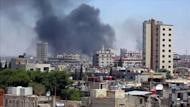 An image grab taken from a video released by the United Nations Supervision Mission in Syria (UNSMIS) shows smoke rising following shelling from the central flashpoint city of Homs on June 11