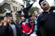 Protesters wave the pre-Baath Syrian flag, now used by the Free Syrian Army, as they shout slogans against the Syrian and Iranian regimes during a demonstration outside the Iranian embassy in the Egyptian capital Cairo on February 6, 2013