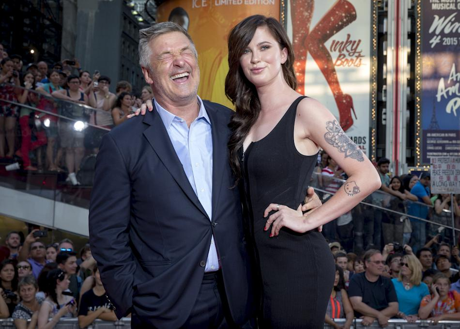 """Actor Alec Baldwin poses with his daughter Ireland Baldwin on the red carpet for a screening of the film """"Mission Impossible: Rogue Nation"""" in New York"""