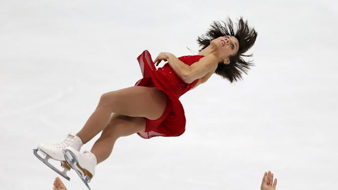 Meagan Duhamel and Eric Radford of Canada perform during the pairs short program at the ISU Grand Prix of Figure Skating in Nagano, Japan