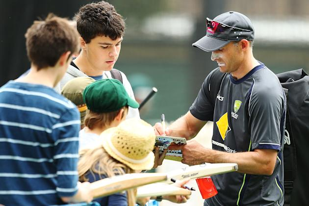 SYDNEY, AUSTRALIA - JANUARY 02:  Michael Hussey of Australia signs autographs for the public after an Australian nets session at Sydney Cricket Ground on January 2, 2013 in Sydney, Australia.  (Photo