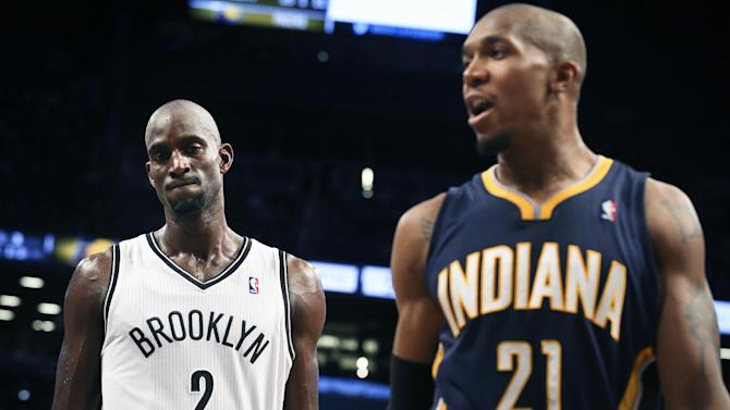 Brooklyn Nets power forward Kevin Garnett (2) reacts alongside Indiana Pacers power forward David West (21) as a call is upheld giving the Pacers the ball during the fourth quarter of a NBA basketball game, Saturday, Nov. 9, 2013, at the Barclays Center in New York. The Indiana Pacers defeated the Brooklyn Nets, 96-91