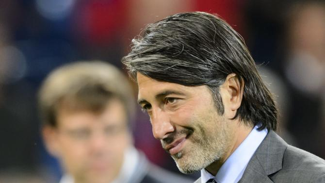 Basel's head coach Murat Yakin reacts, after  the Champions League group E group stage soccer match between Switzerland's FC Basel and Germany's FC Schalke 04 at the St. Jakob-Park stadium in Basel, Switzerland, Tuesday, Oct. 1, 2013