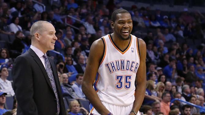 Oklahoma City Thunder forward Kevin Durant (35) laughs as he talks with Sacramento Kings head coach Michael Malone in the fourth quarter of an NBA basketball game against the Kings in Oklahoma City, Sunday, Jan. 19, 2014. Oklahoma City won 108-93