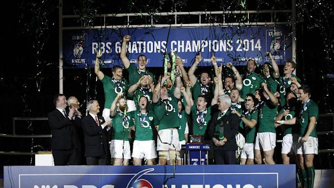 Ireland's rugby team players celebrate after defeating France and winning the Six Nations Rugby Union tournament at the stade de France stadium, in Saint Denis, outside Paris, Saturday, March 15, 2014. (AP Photo/Christophe Ena)