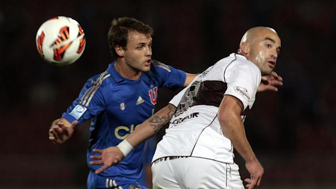 Chile's Universidad de Chile's Juan Ignacio Sills, left, and Argentina's Lanus Santiago Silva go for the ball during a Copa Sudamericana soccer match in Santiago, Chile, Wednesday, Sept. 25, 2013