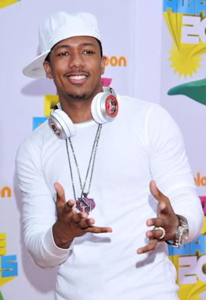 FILE - In this April 2, 2011 file photo, entertainer Nick Cannon arrives at Nickelodeon's 24th Annual Kids' Choice Awards in Los Angeles. Cannon, while attending Super Bowl XLVI in Indianapolis on Sunday, Feb. 5, 2012, said he is now fully healed after being hospitalized last month after suffering from a form of mild kidney failure. (AP Photo/Vince Bucci, File)