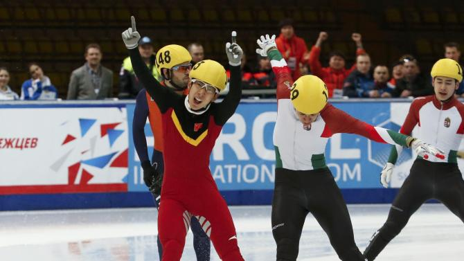 Han Tianyu of China and Liu of Hungary cross finish line during men's 5000m relay final at ISU World Short Track Speed Skating Championships in Moscow