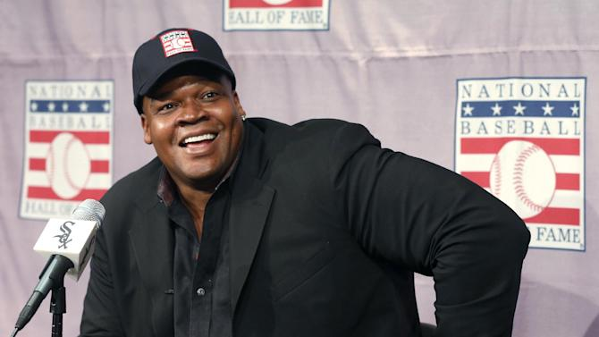 In this Jan. 8, 2014, file photo, Frank Thomas smiles as he listens to a question during a news conference in Chicago about his election to the Baseball Hall Of Fame. Thomas is moving up to the broadcasting big leagues. Thomas will join Greg Maddux and Tom Glavine as players inducted into the Hall of Fame this summer. He said Saturday, Feb. 22, he is completing details on an agreement to work this season as a studio baseball analyst for Fox Sports 1, based in Los Angeles
