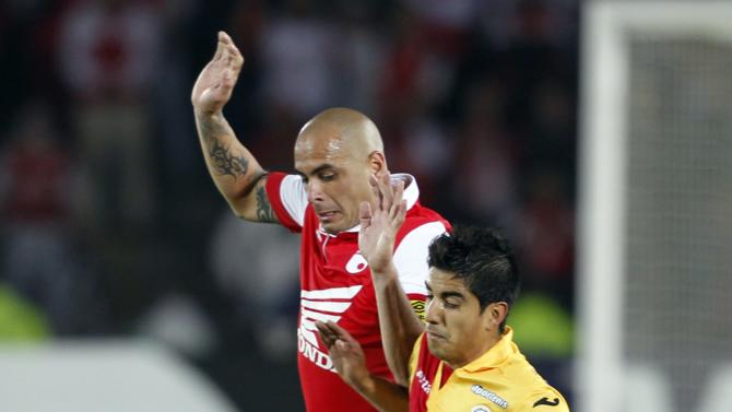 Perez of Santa Fe and Gonzalez of Morelia fight for the ball during their Libertadores Cup soccer match in Bogota
