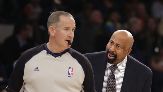 New York Knicks' head coach Mike Woodson, right, yells at a referee during the first half of the NBA basketball game against the Brooklyn Nets at Madison Square Garden, Monday, Jan. 20, 2014, in New York