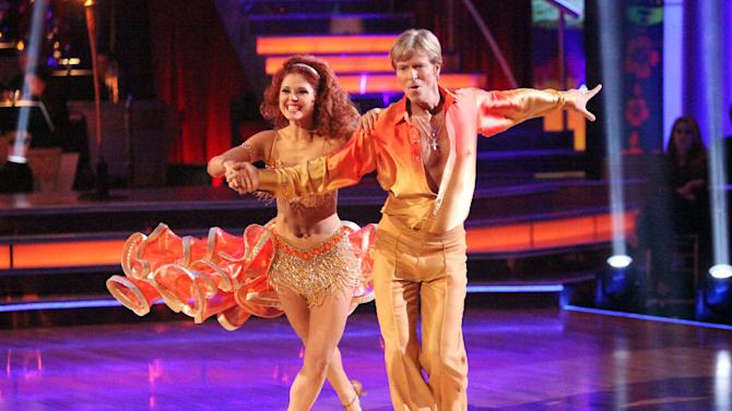 """In this April 2, 2012 image released by ABC,  actor Jack Wagner and his partner Anna Trebunskaya perform on the celebrity dance competition series """"Dancing with the Stars,"""" in Los Angeles. (AP Photo/ABC, Adam Taylor)"""