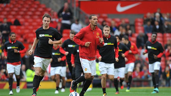 Rio Ferdinand (centre) refused to wear a Kick It Out anti-racism campaign t-shirt on Saturday