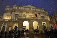 "Guests arrive on opening night at La Scala opera house in Milan. On Friday it celebrated the start of its 2012/2013 season with Richard Wagner's ""Lohengrin"" -- a disputed choice ahead of the bicentenaries of the famous German composer and his Italian rival Giuseppe Verdi"