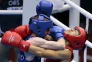 China's Zou Shiming, right, fights Ireland's Paddy Barnes, during their men's semifinal light flyweight 49-kg boxing match at the 2012 Summer Olympics, Friday, Aug. 10, 2012, in London. (AP Photo/Ivan Sekretarev)