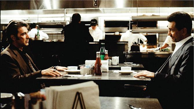 """This 1995 photo released by Warner Bros Pictures shows Al Pacino as Vincent Hanna, left, and Robert De Niro as Neil McCauley in a scene from """"Heat."""" (AP Photo/Warner Bros. Pictures)"""