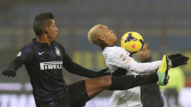 Inter Milan Brazilian defender Juan Jesus, left, challenges for the ball with Parma forward Jonathan Biabiany, of France, during the Serie A soccer match between Inter Milan and Parma at the San Siro stadium in Milan, Italy, Sunday, Dec. 8, 2013