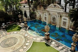 Casa Casuarina's pool is lined in gold. Click the photo to go to the listing (with many more pictures).