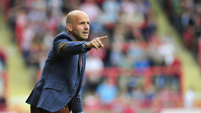 Paul Tisdale hailed a fine finish from Jamie Cureton