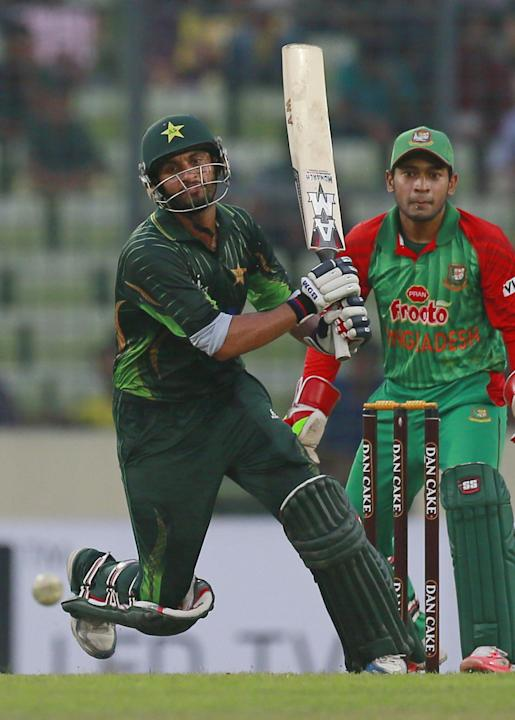 Pakistan's Saad Nasim, left, plays a shot, as Bangladesh's wicketkeeper Mushfiqur Rahim watches during the second one-day international cricket match in Dhaka, Bangladesh, Sunday, April 19, 2015.