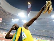 """Jamaican track star Usain Bolt, pictured in 2008, on Thursday acknowledged he has had a rocky build-up to the London Olympics, but declared himself """"ready to go"""" in his bid to defend his double sprint titles"""