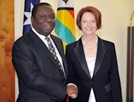 Zimbabwean Prime Minister Morgan Tsvangirai is greeted by Australian Prime Minister Julia Gillard before their official meeting at Parliament House in Canberra, on July 23. Zimbabwe is ready to re-engage with the global community, Tsvangirai said during his visit