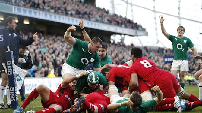 Ireland's Cian Healy, centre left, reacts after Chris Henry scored a try against Wales during their Six Nations Rugby Union international match at the Aviva Stadium, Dublin, Ireland, Saturday, Feb. 8, 2014. (AP Photo/Peter Morrison)