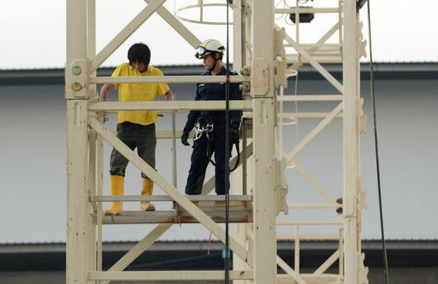 "Both Chinese workers have been arrested for ""unlawfully remaining at the place and intentionally causing alarm"". (AFP Photo)"