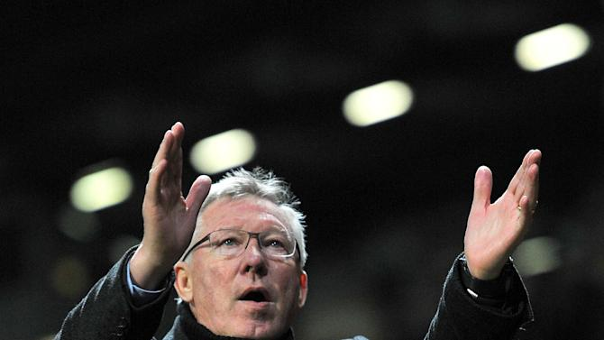 Manchester United manager Sir Alex Ferguson applauds the fans after the comeback win over Braga