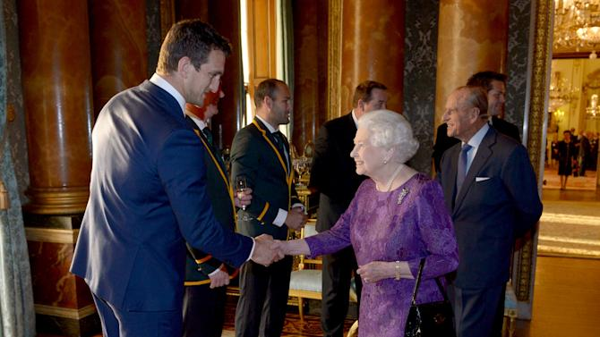 Britain's Queen Elizabeth meets Wales' Rugby Union Captain Sam Warburton at a reception at Buckingham Palace to welcome Rugby World Cup participants