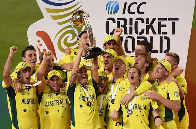 Australian captain Michael Clarke holds aloft the trophy with his teammates as they celebrate their seven wicket win over New Zealand in the Cricket World Cup final in Melbourne, Australia, Sunday, Ma